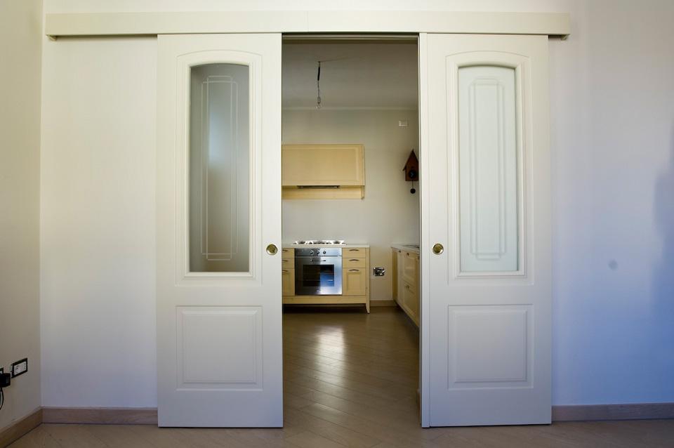 Porta scorrevole doppia a fontana serramenti e infissi in alluminio e legno per la casa l - Porta scorrevole da interno ...